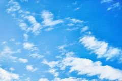 The blue sky with clouds. Vivid background stock photography