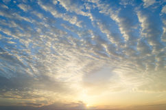 Blue sky, clouds and bright sun, beautiful scenery, free space. Stock Images