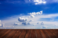Blue sky with clouds and brown wood Royalty Free Stock Photo