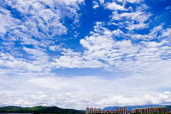 Blue sky. Clouds and blue sky and buildings Stock Photos