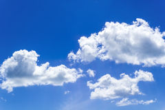 Blue sky clouds. Closeup blue sky and fluffy clouds background Stock Image
