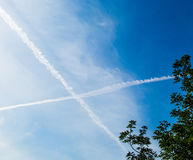 Blue Sky with and clouds and a cross in sky. Blue Sky with white  and clouds and a cross in sky Stock Photo