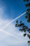 Blue Sky with and clouds and a cross in sky Royalty Free Stock Image