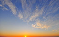 Blue sky with clouds with the daybreak. Sunshine Royalty Free Stock Image