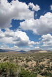 Blue sky with clouds in the desert Royalty Free Stock Images
