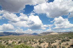 Blue sky with clouds in the desert Stock Image