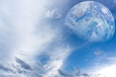 Blue sky with clouds and earth. Elements furnished by NASA.  Royalty Free Stock Photo