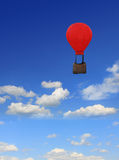 Blue sky with clouds, floating hot-air balloon. Floating hot-air balloon nostalgic design, blue sky with clouds and copy space royalty free stock image