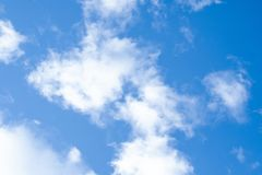 Blue sky with clouds. Blue sky with fluffy white clouds background nature beauty color bright day weather heaven beautiful abstract summer light space outdoor royalty free stock photography