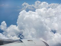 Cloudy sky from plane. Blue sky with clouds from flying plane stock images