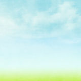 Blue sky, clouds and green field summer background Stock Photography