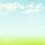 Blue sky, clouds and green field summer background Royalty Free Stock Photo