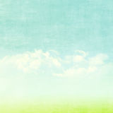 Blue sky, clouds and green field summer background Stock Photo