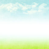 Blue sky, clouds and green field summer background Royalty Free Stock Images