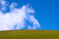 Blue Sky with Clouds and Green Valley Background Stock Image