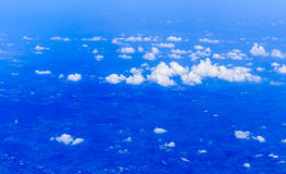 Blue sky and Clouds looking from the Airplane Stock Photography