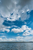 Blue sky with clouds and marsh Stock Image