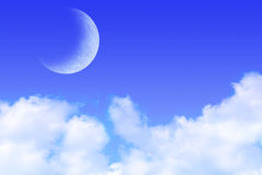 Blue Sky Clouds and Moon Stock Photo