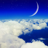 Blue sky, clouds and moon Stock Photography