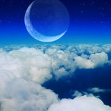 Blue sky, clouds and moon Stock Images