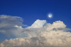 Blue sky with clouds and moon Stock Photography