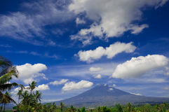 Blue sky, clouds, mountain and coconut tree Royalty Free Stock Images