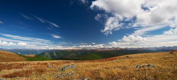 Blue sky, clouds and mountains. Altay. Russia Stock Photos