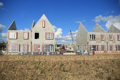 Blue sky with clouds and new houses under construction. Royalty Free Stock Images