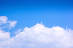 Blue sky and clouds at noon on clean air. Royalty Free Stock Photo
