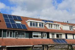 Solar panels on the roof of the house in spring. stock images