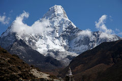 Blue sky and clouds over Ama Dablam. Royalty Free Stock Image