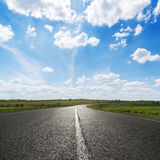 Blue sky with clouds over asphalt road Stock Images