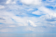Blue sky with clouds over calm water Sea of Azov Royalty Free Stock Image
