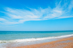 Blue sky with a clouds over the coast of the sea Stock Photo