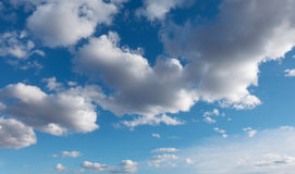 Blue sky with clouds over horizon. Stock Images