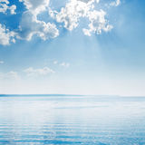 Blue sky with clouds over river Royalty Free Stock Photos