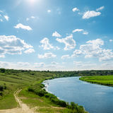 Blue sky with clouds over river Stock Image