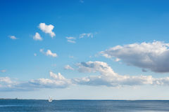 Blue sky with clouds over river Stock Photos