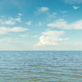 Blue sky and clouds over sea Royalty Free Stock Photos