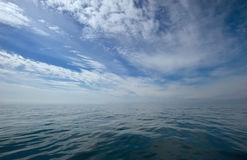 Blue sky with clouds over sea. Stock Photography