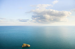 Blue sky with clouds over sea. Royalty Free Stock Photography