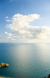 Blue sky with clouds over sea. Stock Images