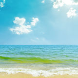 Blue sky with clouds over sea. Blue sky with clouds and sun over sea Stock Photos