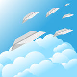 Blue sky clouds paper airplane background Stock Photo