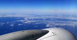 Blue Sky and Clouds from Plane, Flying to Madeira Island in Portugal, slow motion. 4K stock footage