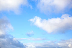 Blue sky with clouds. Blue sky with puffy white clouds stock images
