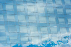 Blue sky and clouds reflected in office building Royalty Free Stock Images