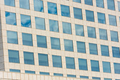 Blue sky and clouds reflected in office building Royalty Free Stock Photography