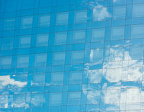 Blue sky and clouds reflected in office building Stock Photos