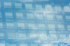 Blue sky and clouds reflected in office building Stock Image